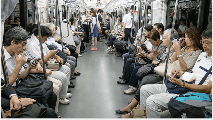 A ride in Tokyo subway, mobile users in the train